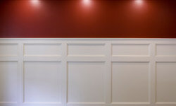 Wainscoting adds texture and depth to your walls. Here, the clean white wainscoting sets off the rich crimson paint.