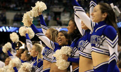Cheerleaders, such as this squad from Duke University at a 2011 basketball game, help add to the excitement of sports, even for those watching the game on TV.