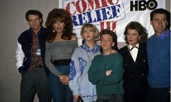 "Katey Sagal (second from left) in full Peggy Bundy regalia, surrounded by the cast of ""Married with Children"" at Comic Relief 3, in 1989"