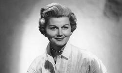 "June Cleaver (played by Barbara Billingsley) often wore pearls while doing housework on ""Leave it to Beaver."""