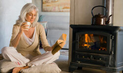 Heating your most-used rooms with a fireplace can help you lower your energy bill.