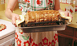 Though you may want to go for something more ambitious than a roast, little touches like a hostess apron in an intensely retro print will bring your guests back to the nifty '50s.