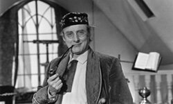"""Comedian Spike Milligan as Dr. Strabismus on the 1960s BBC series """"World of Beachcomber."""""""