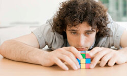 Many a player has tried to best this colorful puzzle cube.