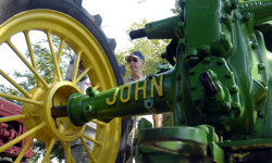 David Bunning looks over his 1936 John Deere tractor during the 15th Arkansas Antique Tractor and Engine Show, in Scott, Ark.