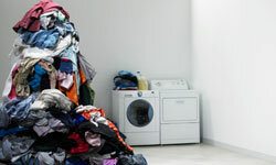 Front-loading washers will help you keep organized, but finding a spot to store your dirty laundry is still up to you.