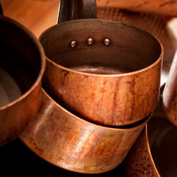Copper pots that need a good cleaning.