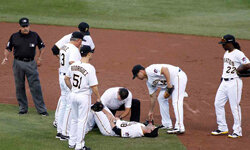 Neil Walker of the Pittsburgh Pirates grimaces in pain after injuring his hand attempting to turn a double play against the Los Angeles Dodgers on Aug. 15, 2012, at PNC Park in Pittsburgh, Pa. See more Sports Pictures.