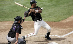 Moises Alou of the San Francisco Giants dodges a wild pitch during a Spring Training Cactus League game against the Colorado Rockies on March 24, 2006, at the Scottsdale Stadium in Scottsdale, Ariz.