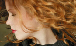 Just look at these lovely curly red locks. Who would want to straighten them?