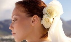 You don't need a professional hairstylist to look your best on your wedding day. Many beautiful styles can be created all by yourself. See pictures of money-saving wedding tips.