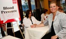 "Actress and model Emme Aronson, right, has her blood pressure checked at the ""Sister to Sister Everyone Has a Heart"" breakfast for women business executives, in New York."