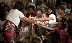 Michelle Obama greets kids at the White House for Take Our Daughters and Sons to Work Day.