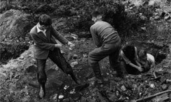 January 1955: A group of young men digging at Borley rectory in search of the skeleton of a nun thought to have died mysteriously there.