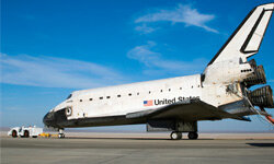 After landing, the Space Shuttle Atlantis is towed to facilities for post-flight processing.
