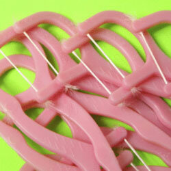 If traditional floss is hard to get between your teeth, try superfloss, dental tape or interdental brushes.