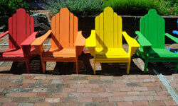 Colorful Adirondack chairs will add a pop of personality to an outdoor space.