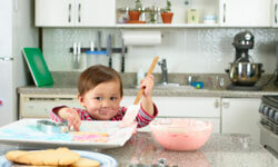 The kitchen can be a fun place for a child to learn and interact with you, but it has quite a few dangers lurking around every countertop and cabinet. See more pictures of kid-friendly recipes.