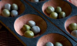 The setup for Mancala is an array of cups -- you can even use an egg carton, if you want to.