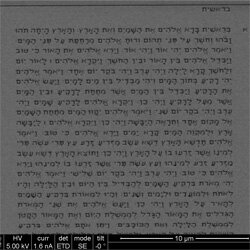 It's a page from a nano-Bible (in Hebrew), as seen through an electron microscope (and magnified). Israeli researchers fit the whole Bible on a 0.5-square-millimeter silicon chip.