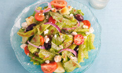 Traditional Greek salads don't have lettuce, but feel free to add some green leaves if you want to.