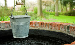 With a biofuel-powered pump, you can skip tugging a bucket up and down as with wells of the past.