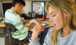 Get that pen out of your mouth. You risk ingesting germs, and it's bad for your teeth.