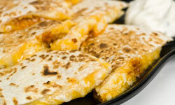Quesadillas are cheesy, cheap and delicious.