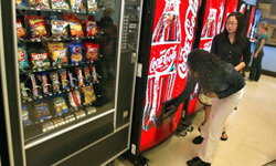 Students purchase soft drinks from vending machines at Jones College Prep High School April 20, 2004, in Chicago, Ill. We know soda's loaded with sugar, but did you know it's a high-sodium beverage, too?
