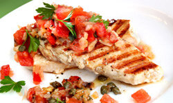 Salsa isn't just for eating with tortilla chips. Use it as a garnish for lighter meats.