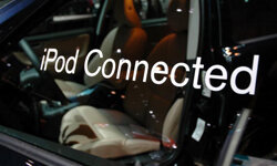 A sign on the window of a Volvo V70R indicates the vehicle's audio system is wired to accept a driver's iPod portable music player.
