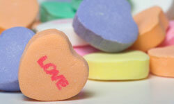 Scatter candy hearts on the table for a super-sweet setting.