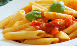 A light pasta tossed with tomatoes and extra-virgin olive oil is ready-made for spring dining al fresco.