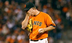 Matt Cain of the San Francisco Giants reacts after giving up a run against the Los Angeles Dodgers during the sixth inning at AT&T Park on July 27, 2012, in San Francisco, Calif. See more Sports Pictures.