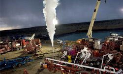 Water, acid, sand and liquid carbon dioxide are injected under heavy pressure into a natural gas well in New Mexico.