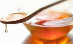 Make your own cough syrup with honey.