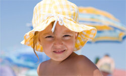 Good job on the hat, little one. Don't forget to demand some sunscreen for your delicate skin.