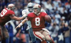 San Francisco quarterback Steve Young tries to avoid a Cowboys sack in the 1993 NFC Championship Game.