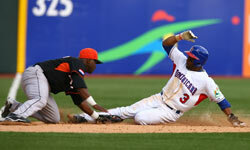 Willy Taveras of The Dominican Republic is tagged out trying to steal third base by Yurendell DeCaster of The Netherlands during the 2009 World Baseball Classic.