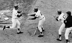 New York Mets outfielders Tommie Agee (center) and Rod Gaspar (right) greet second baseman Al Weis after Weis tied the score in the fifth game of the 1969 World Series.