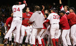 Boston Red Sox players celebrate after David Ortiz hit the game winning two-run home run in the 12th inning against the Yankees in game four of the 2004 American League Championship Series. See more sports pictures.