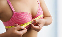 Breasts might grow at different rates during puberty.