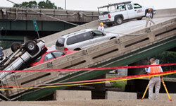 FBI agents investigate the collapse of the I-35W Bridge in Minneapolis, a disaster apparently caused by an inherent design weakness. See more bridge pictures.