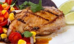Chicken breasts can be cooked 100 ways, including grilled with a fruit salsa.