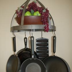 Try hanging useful tools like pots and pans from the wall.