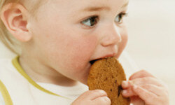 Both healthy foods and sweet snacks can be hazardous to young children.