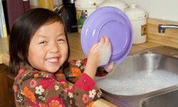Your children may not like doing chores as much as this little cutie does, but they have to be responsible.