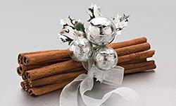 A silver bow turns cinnamon sticks into pretty décor.