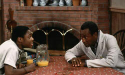 "Theo and Cliff share some family time around the uncluttered kitchen table of ""The Cosby Show."""
