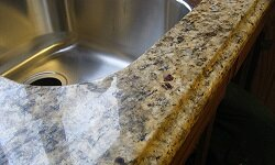 Granite counters may be a popular choice, but they aren't low-maintenance.